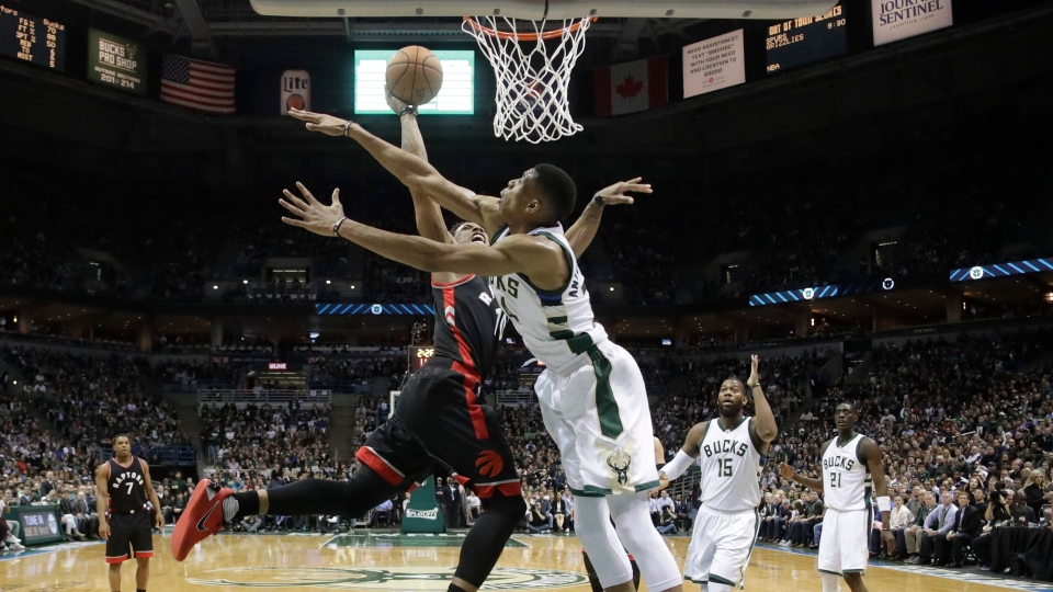 Toronto Raptors' DeMar DeRozan tries to shoot past Milwaukee Bucks' Giannis Antetokounmpo during the first half of Game 6 of an NBA first-round playoff series basketball game Thursday, April 27, 2017, in Milwaukee. (AP Photo / Morry Gash)