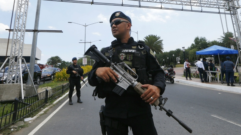 FILE - Philippine National Police SWAT officers guard near the entrance to the Philippine International Convention Center in suburban Pasay city, south of Manila, Philippines on Wednesday, April 26, 2017. (AP / Bullit Marquez)