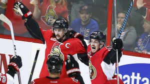 Ottawa Senators defenceman Erik Karlsson celebrates his goal against the New York Rangers with teammates centre Jean-Gabriel Pageau and defenceman Marc Methot during the third period in game one of a second-round NHL hockey Stanley Cup playoff series in Ottawa on Thursday, April 27, 2017. (Fred Chartrand / THE CANADIAN PRESS)