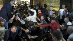 Protesters clash with police to enter into the parliament building in Skopje, Macedonia, Thursday, April 27, 2017. (AP / Dragan Perkovski)