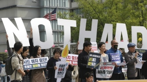 South Koreans hold letters reading 'NO THAAD' during a rally to oppose a plan to deploy an advanced U.S. missile defense system called Terminal High-Altitude Area Defense, or THAAD, near the U.S. Embassy in Seoul, South Korea on Friday, April 28, 2017. (AP / Lee Jin-man)