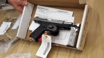 A 9mm gun, a part of evidence in the first-degree murder trial of William Sandeson, charged in the death of Dalhouse University student Taylor Samson, is shown in court on Thursday, April 27, 2017.  (THE CANADIAN PRESS/Kieran Leavitt)