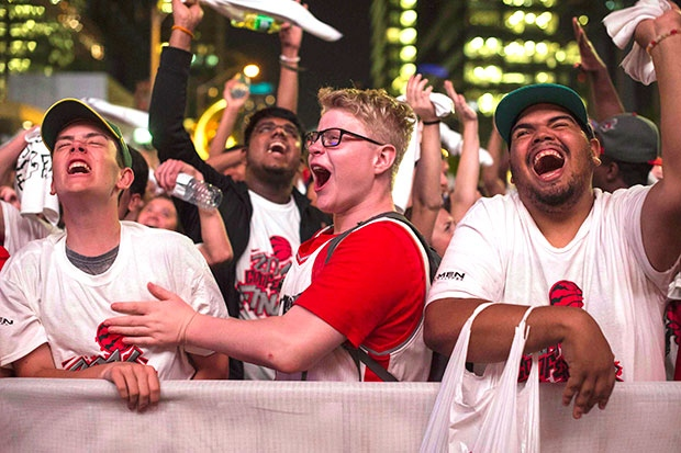 Toronto Raptors' fans watch the action on the big screen outside the Air Canada Centre during game six Eastern Conference final NBA playoff basketball action against the Cleveland Cavaliers in Toronto on Friday, May 27, 2016. THE CANADIAN PRESS/Eduardo Lima