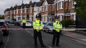 Police cordon the area in London's Harlesden Road, on April 28, 2017. (Stefan Rousseau/PA via AP)
