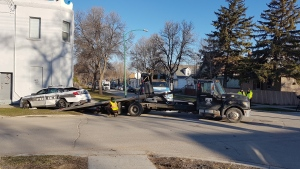 Two police officers were taken to hospital after a traffic pursuit ended in a crash at the intersection of McKenzie Street and Pritchard Avenue. (Photo: Courtney Dumas/CTV Winnipeg)