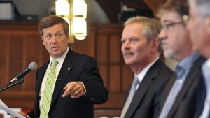 From left: John Tory, Jim Keohane, David Herle and Jon Chevreau in Toronto on May 30, 2012. (The Canadian Press Images / Healthcare of Ontario Pension Plan)