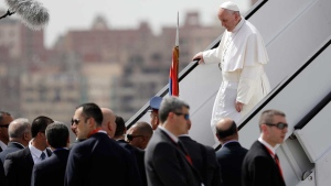 Pope Francis walks down the steps of an airplane upon arriving at Cairo's airport, Egypt, Friday, April 28, 2017. (AP Photo/Gregorio Borgia)