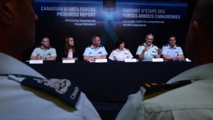 Major-General Blaise Cathcart, Judge Advocate Feneral of the CAF, second from right, speaks as he is joined by fellow experts during a Canadian Armed Forces press conference at the National Defence Headquarters in Ottawa on Friday, April 28, 2017, addressing inappropriate sexual behaviour in the forces. THE CANADIAN PRESS/Sean Kilpatrick