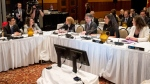 Quebec's Minister of Justice and Attorney General Stephanie Vallee, far right, and Minister of Justice and Attorney General of Canada Jody Wilson-Raybould, second from right, speak with Ontario's Attorney General Yasir Naqvi, far left, at the Federal-Provincial-Territorial Meeting of Ministers Responsible for Justice in Gatineau on Friday, April 28, 2017. THE CANADIAN PRESS/Justin Tang