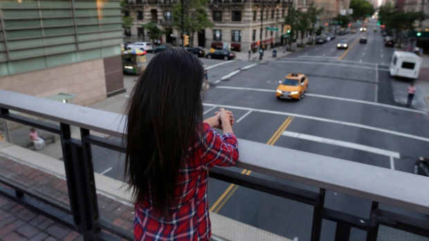 In this July 12, 2016, photo, Sameena, 22, a member of the Indian Dawoodi Bohra community, overlooks Amsterdam Ave. from a bridge during an interview with the Associated Press, in New York. Sameena was circumcised at seven.  (AP Photo/Julie Jacobson)