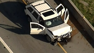 A damaged vehicle is seen from CTV's Chopper 9 as it flew over Highway 1 on Friday, April 28, 2017.