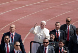 Pope Francis waves as he arrives to celebrate Mass for Egypt's tiny Catholic community, at the Air Defense Stadium in Cairo, Saturday, April 29, 2017. (AP Photo/Amr Nabil)