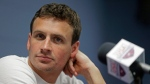 In this May 12, 2016, file photo, Ryan Lochte listens to a question from the media in Charlotte, N.C. (AP Photo/Chuck Burton, File)