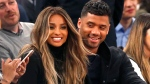 In this Feb. 9, 2016, file photo, singer Ciara, centre left, and Seattle Seahawks quarterback Russell Wilson sit courtside during a NBA basketball game between the New York Knicks and the Washington Wizards in New York. (AP Photo / Kathy Willens)
