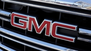In this April 25, 2017, photo, a GMC truck sits in a General Motors dealer's lot in Nashville, Tenn. General Motors Co. reports financial results, Friday, April 28, 2017. (AP Photo/Mark Humphrey)