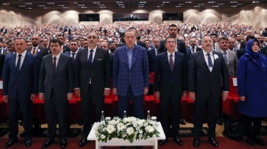 Turkey's President Recep Tayyip Erdogan, centre, stands as he listens to the national anthem, prior of delivering a speech at a conference in Istanbul, Saturday, April 29, 2017.  (Press Presidency Press Service via AP, Pool)