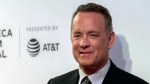 "FILE - In this April 26, 2017 file photo, Tom Hanks attends ""The Circle"" premiere during the 2017 Tribeca Film Festival in New York. (Photo by Charles Sykes/Invision/AP)"