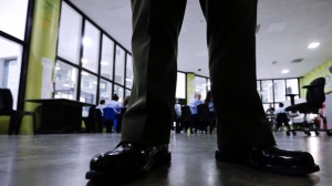 A Sheriff officer stands guard over inmates during a program at the Twin Towers Correctional Facility Thursday, April 27, 2017, in Los Angeles. (AP Photo/Chris Carlson)