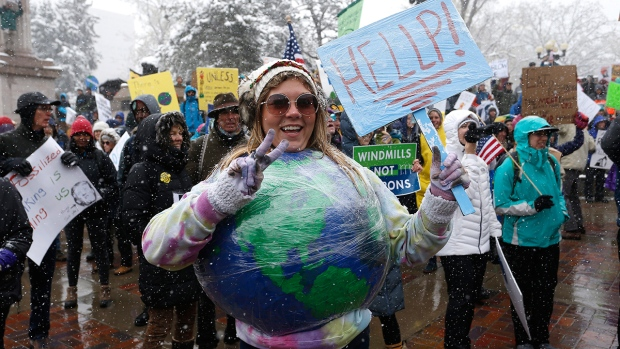 Amy Guerrieri, of Fort Collins, Colorado, wears a home-made model of earth and participates in a climate change awareness march and rally, in Denver, Saturday, April 29, 2017. (AP / Brennan Linsley)