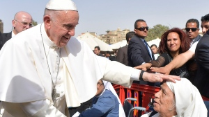 Pope Francis caresses a nun during a meeting with the clergy and religious, in Cairo, Saturday, April 29, 2017. (L'Osservatore Romano / Pool Photo via AP)