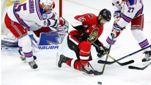 Ottawa Senators left wing Clarke MacArthur (16) battles for the puck with New York Rangers defenceman Dan Girardi (5) and Rangers defenceman Ryan McDonagh (27) during the first period in game two of a second-round NHL hockey Stanley Cup playoff series in Ottawa on Saturday, April 29, 2017. (THE CANADIAN PRESS / Fred Chartrand)