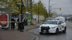 Langley RCMP are seen at the scene of standoff at the Logan Avenue bus loop on Saturday afternoon.