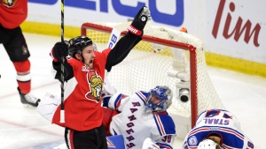 Ottawa Senators right wing Mark Stone (61) celebrates his goal on New York Rangers goalie Henrik Lundqvist (30) as New York Rangers defenceman Marc Staal (18) reacts during the third period in game two of a second-round NHL hockey Stanley Cup playoff series in Ottawa on Saturday, April 29, 2017. (THE CANADIAN PRESS / Adrian Wyld)