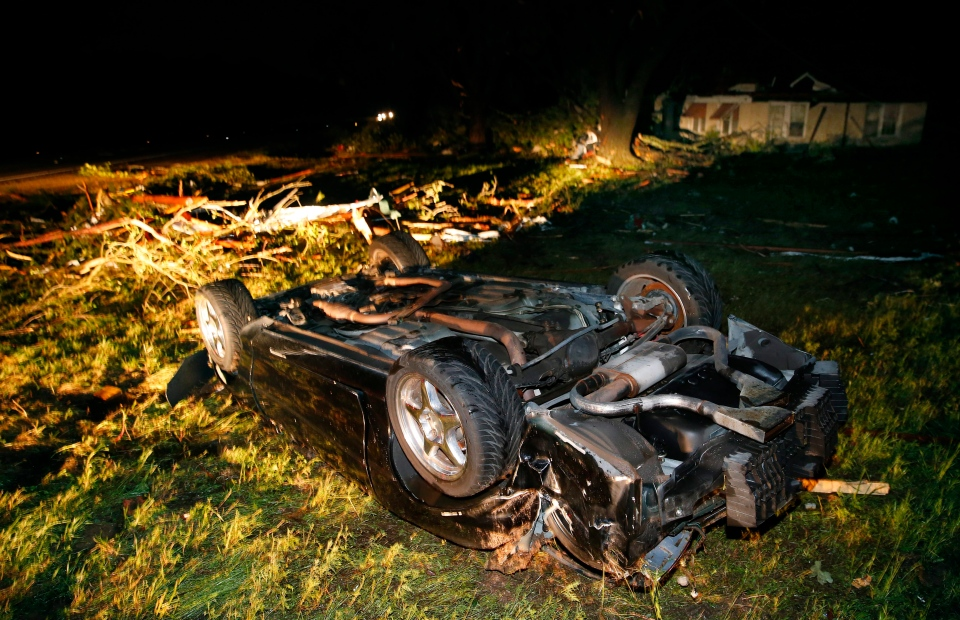 A car that barrel-rolled lies in an empty field along State Highway 80 in Fruitvale, Texas, after a tornado swept through late Saturday, April 29, 2017. Fruitvale is north of Canton. (Tom Fox/The Dallas Morning News via AP)