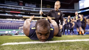 Mississippi State offensive lineman Justin Senior is measured for flexibility at the NFL football scouting combine Friday, March 3, 2017, in Indianapolis. THE CANADIAN PRESS/AP/David J. Phillip