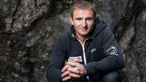 In this Sept. 11, 2015 file photo Swiss climber Ueli Steck poses for a photo at the foot of a climbing wall in Wilderswil, Canton of Berne, Switzerland. (Christian Beutler/Keystone via AP)