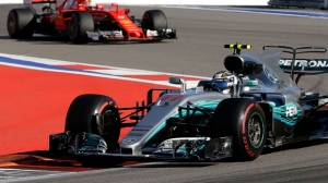 Mercedes driver Valtteri Bottas of Finland takes a curve followed by Ferrari driver Sebastian Vettel of Germany during the Formula One Russian Grand Prix at the 'Sochi Autodrom' circuit, in Sochi, Russia, Sunday, April. 30, 2017. (AP Photo/Sergei Grits)