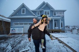 Chris Flett and his daughter Jessica are shown at his new Beacon Hill house after it was rebuilt after losing it to the wildfires last year in Fort McMurray, Alta., Thursday, April 20, 2017. (Todd Korol / THE CANADIAN PRESS)
