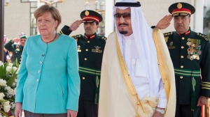 In this photo released by the Saudi Press Agency, SPA, German Chancellor Angela Merkel, left, is received by Saudi King Salman on her arrival to Jiddah, Saudi Arabia, Sunday, April 30, 2017. (Saudi Press Agency via AP)