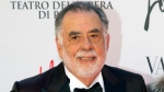"FILE - In this May 22, 2016 file photo, director Francis Ford Coppola poses for photographers as he arrives for the premiere of Verdi's ""La Traviata'' at the Rome Opera House, in Rome.  (AP Photo/Andrew Medichini, File)"