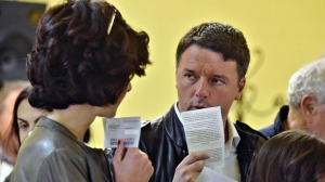 Former Italian Premier Matteo Renzi and his wife Agnese arrive to vote for the Democratic party's primary elections, in Florence, Italy, Sunday, April 30, 2017.(Maurizio Degl'Innocenti/ANSA via AP)