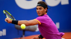Rafael Nadal of Spain returns the ball to Dominic Thiem of Austria during their singles final match at the Barcelona Open Tennis Tournament in Barcelona, Spain, Sunday, April 30, 2017. (AP Photo/Manu Fernandez)