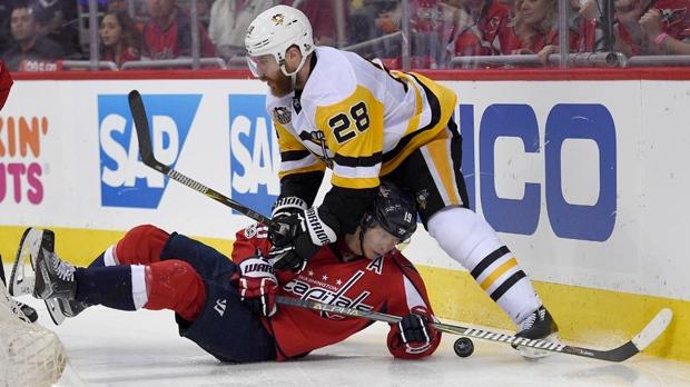 Pittsburgh Penguins defenseman Ian Cole (28) battles for the puck against  Washington Capitals center Nicklas Backstrom (19) 23ffd981175f