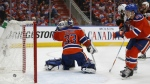 Anaheim Ducks centre Ryan Getzlaf score past Edmonton Oilers goalie Cam Talbot as Oilers defenceman Matthew Benning looks on during first period NHL hockey round two playoff action in Edmonton on Sunday, April 30, 2017. (Jeff McIntosh / THE CANADIAN PRESS)
