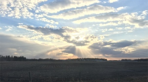 Sunshine behind the clouds overlooking the farm. Photo by Jessa Laine Firman.