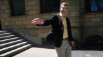 Nova Scotia Premier Stephen McNeil waves to a passerby as he leaves Province House in Halifax following a press conference on Tuesday, June 3, 2014. (THE CANADIAN PRESS/Darren Pittman)