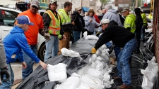 Volunteers place sandbags in Missouri