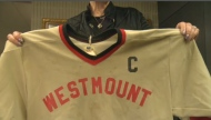 Ruth Ellis shows her son  Doug's hockey jersey. He was abused by his former coach John Garland.