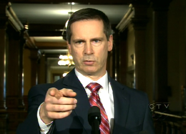 Ontario Premier Dalton McGuinty points while speaking to reporters at Queen's Park in Toronto, Tuesday, March 24, 2009.