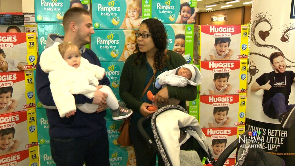 Ashleigh Miller Cross (right) holds newborn baby Ezra at an Atlantic Superstore in Halifax. (CTV Atlantic)