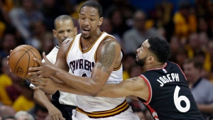 Toronto Raptors' Cory Joseph (6) puts pressure on Cleveland Cavaliers' Channing Frye, centre, in the first half in Game 1 of a second-round NBA basketball playoff series, Monday, May 1, 2017, in Cleveland. (Tony Dejak/THE ASSOCIATED PRESS)