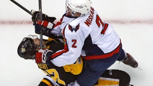 Pittsburgh Penguins' Sidney Crosby (87) takes a hit from Washington Capitals' Matt Niskanen during the first period of Game 3 in an NHL Stanley Cup Eastern Conference semifinal hockey game against the Washington Capitals in Pittsburgh, Monday, May 1, 2017. (Gene J. Puskar/AP)
