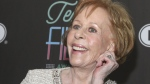 FILE - In this March 10, 2016 file photo, Texas Film Hall of Fame honoree Carol Burnett tugs on her ear at the 2016 Texas Film Awards at Austin Studios in Austin, Texas. (Photo by Jack Plunkett/Invision/AP, File)