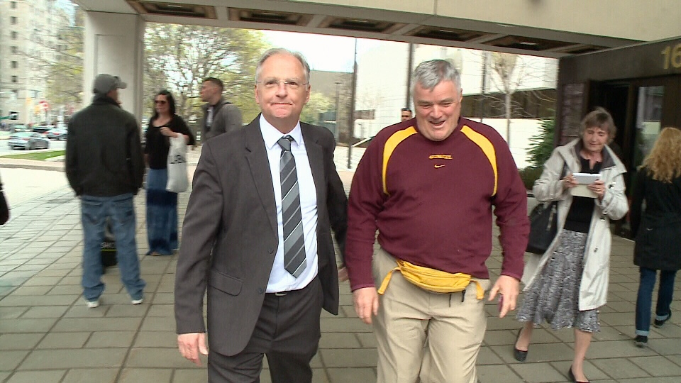 Stephen Amesse (left) leaves Elgin courthouse.