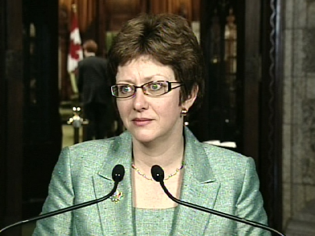 Human Resources Minister Diane Finley speaks to reporters outside the House of Commons on Parliament Hill, Tuesday, March 24, 2009.