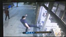 Security video of La Bottega window smashed
